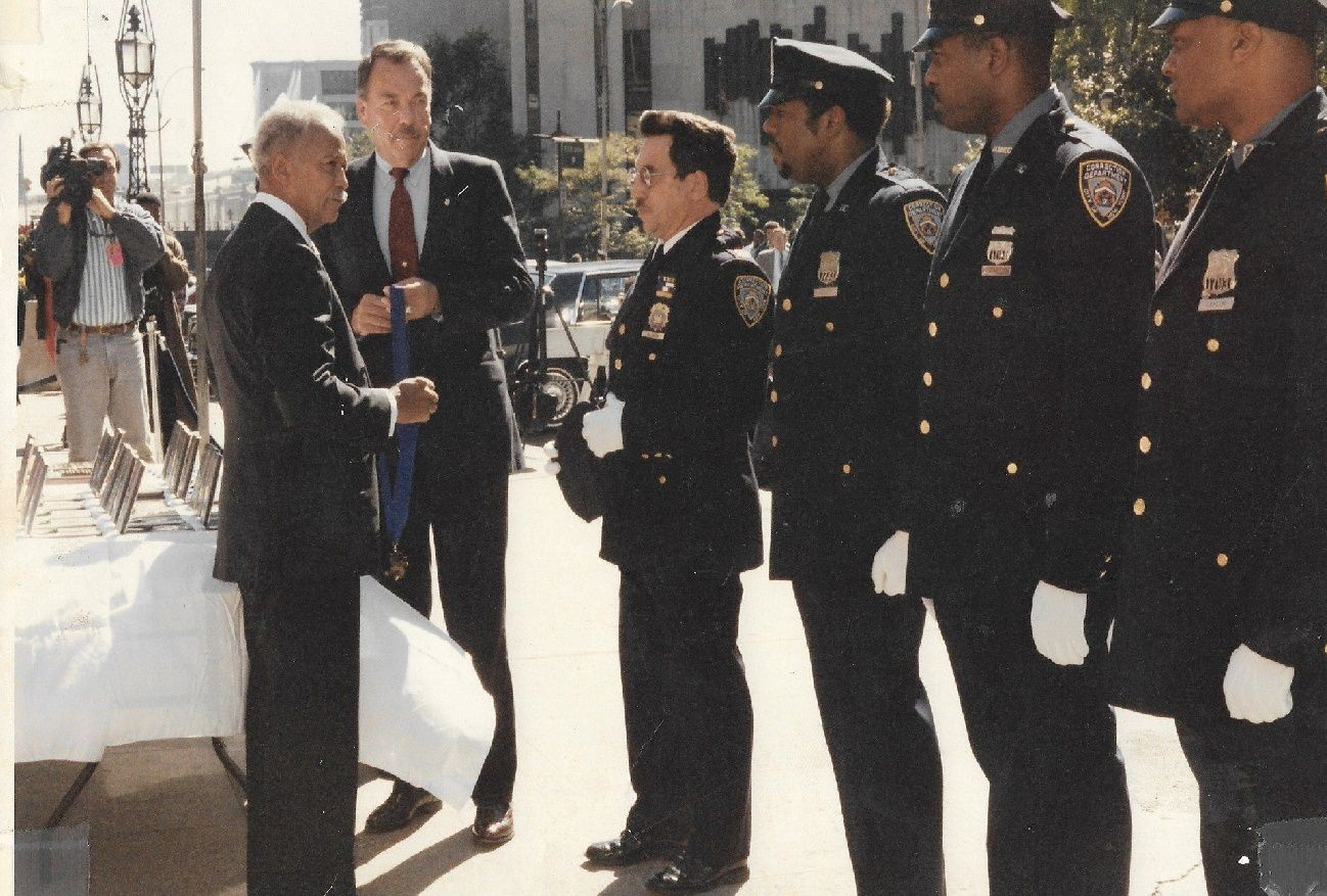 Correction Officer Neal L. Gossett receiving the Honorable Mention Medal from Mayor David Dinkins